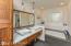 Master Bath-soaking tub, walk in shower, heated floors and custom walnut cabinets, blue tooth speaker
