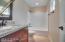 Master Bathroom: Formica counter top, tile flooring, recessed lighting