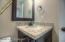 Bathroom: Formica counter top, tile flooring