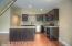 Kitchen: Formica Counters, Stainless Steel Appliances, Crown Molding, Laminate Flooring, Tile back-splash