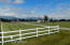 Driveway entrance with fenced yard, huge back yard and Talkeetna Mountain backdrop