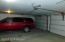 Interior garage with double doors and room for 2 large vehicles plus storage.