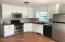 Custom made cabinets with hardwood maple flooring in kitchen, master bedroom & bath
