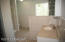 Owners en-suite bath with lots of natural light and beautiful ceramic tile.