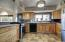 Kitchen features extra height lower cabinets for ease of working on counters.