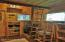 The cabin is furnished with handmade, rustic wood furnishings which will sell along with the property.