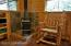A wood stove with beautiful slate surround is located in the SW corner of the cabin. A portable electric heater provides an alternate heat-source.