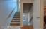 Main Stairs up to second floor and down to unfinished walk out basement