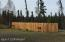 Decorative privacy fence hides your fuel tanks and generator building.