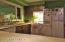The kitchen has easy sight-lines to the dining room and living areas.
