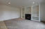 Custom built in cabinets around the granite surround gas fireplace, new carpet