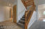 Lighted stairway, storage under the stairs, access to the lighted crawlspace