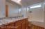 Upstairs bathroom, New Granite Countertop and wood like vinyl plank flooring