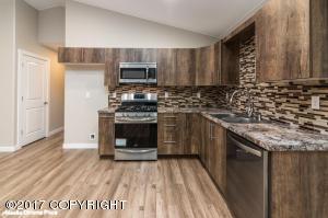 Kitchen: Stainless Steel Appliances, Laminate Flooring, Tile back-splash