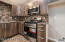Kitchen: laminate flooring, recessed lighting, stainless steel appliances, tile back-splash