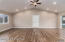 Livingroom: Laminate flooring, recessed lighting, ceiling fan