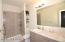 Tiled shower in master w/double sinks.