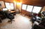A large home office that can be used for work, home schooling, sewing or crafting.