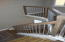 Stained wood tread/steps and posts with metal conduit balusters.