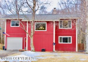 Brick red farmhouse color with bright white modern trim outlined with tall Birch trees...this house pops with curb appeal. Just a hint of what's to come inside...