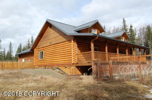 "Exterior front and side of this beautiful log home with 8"" milled logs for great warmth and appealing Alaskan feel."