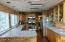 Wonderful walk-through kitchen with stainless steel appliances and loads of cabinet and counter space...