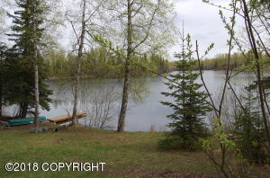 Lots of beautiful Rainbow Lake frontage with this income producing property.