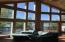 Breathtaking wall of windows brings the sunshine in...complete with window coverings to keep it out when necessary...