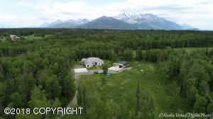 5 acres of privacy with double shop, sauna, heated parking pads and so much more. Read description in listing for details.