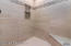 Master Bathroom: Quartz Counter tops, tiled shower, jetted tub, 2 walk-in closets