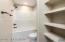Bathroom: Quartz Counter tops, built-in linen shelves