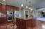 Gorgeous kitchen with large center island and double ovens