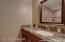 Beautiful full guest bathroom, with high-end cabinets & granite counters