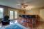 Bonus room/Mancave with full size wet bar, french doors to floating balcony