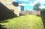 3,002 sqf fenced yard w/ established lawn and landscaped border.