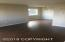 Living/dining areas with new wood laminate flooring and fresh paint.