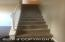 Freshly carpeted staircase with newer custom built railing