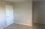 offers west-facing double window, generous closet & alcove for desk, vanity or crib