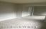 East facing bedroom includes large, mirrored closet & double window to backyard.