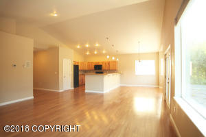 Spacious living room, dining area, and kitchen