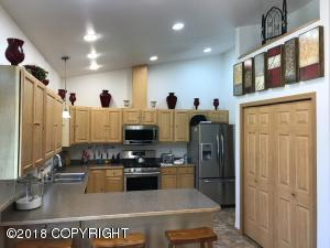 Spacious kitchen with plenty of room for your treasures above the shelves, huge pantry closet, and eating bar...