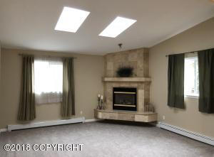 Skylights for an abundance of natural lighting, vaulted ceilings, tiled gas fireplace.