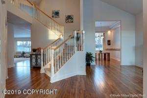 Grand entrance with curved staircase and soaring ceilings!