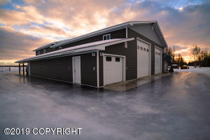 5,184 square foot home with 160 fenced and cleared acreage.