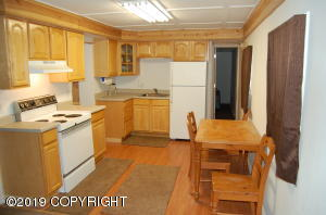Very ample kitchen area with appliances included.