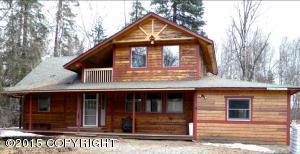 Cedar siding and a wrap porch