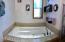 Large Jacuzzi Tub in Main Master Suite Bath...