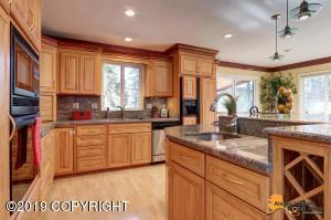 Great spacious kitchen with large island with prep sink, appliance barns, wine rack.