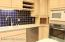 Solid surface counters, built-in wine rack, bread box and microwave