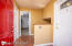 Spacious Common Area entry with a coat closet, access to garage and carport, yard, sheds, and utility room